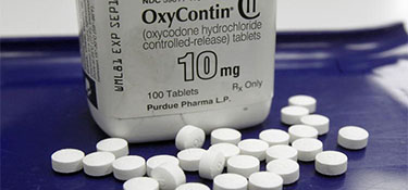 Bottle of oxycontin and pills