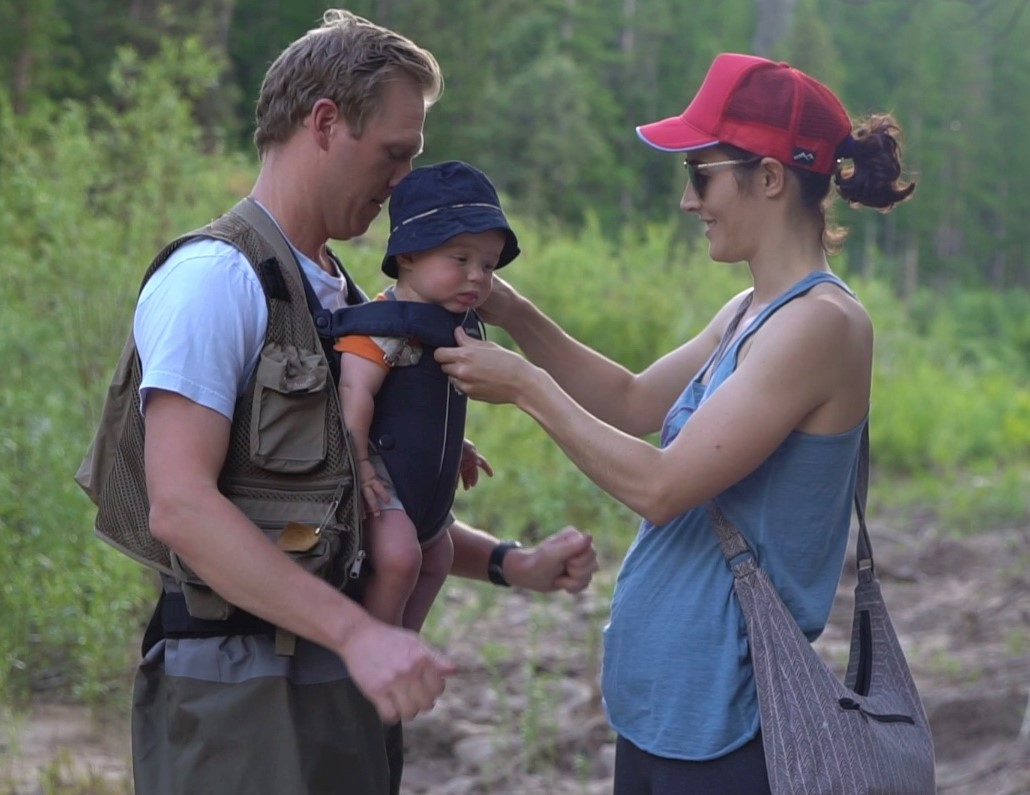 Resident Jon James, with his son strapped to his chest, and his wife prepare to go fly fishing.